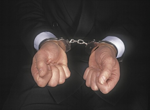 Stock Photo: 1597-114512 Business, Business Metaphors, Caucasian, Concepts, Convicted, Crime, Criminal, Finance, Fraud, Hand, Hand cuffs, Handc
