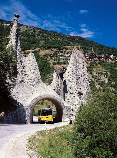 Stock Photo: 1597-115517  postal car, Switzerland, Europe, Valais, Euseigne, cliff, formations, cliff pyramid, Pyramides, tunnel, bus, transport