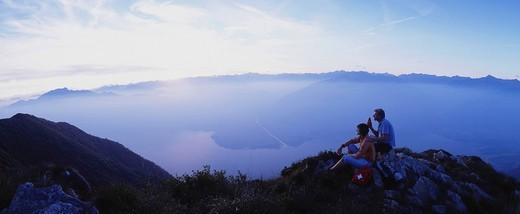 Stock Photo: 1597-119113 couple, rest, dusk, twilight, view, mood, panorama, smoke, mountains, hiking, sports, spare time, Monte Gambarogno, La