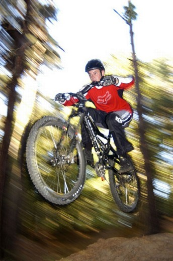 Stock Photo: 1597-11924 action, bicycle, bike, blurred, BMX, cycling, Dynamic, helmet, jump, man, Sports