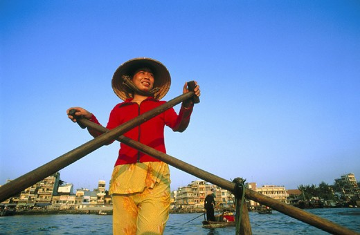 Stock Photo: 1597-119363 10643399, Boat Woman, Cantho, woman, life, Mekong delta, person, rowing boat, town, city, straw hat, Vietnam, Asia,