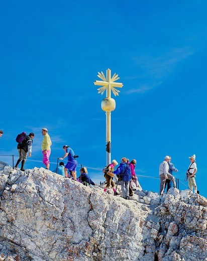 Stock Photo: 1597-120106  walking, hiking, group, Zugspitze, summit, peak, rocky, summit cross, golden, Germany, Europe, Bavaria, mountain walki