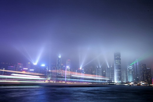 Stock Photo: 1597-120784 China, Asia, Hong Kong, View, from Kowloon, Skyline, April 2008, at night, sky tracker, light, city, town, foggy, sea,