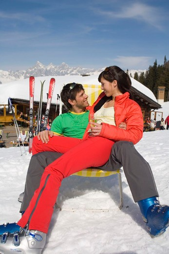 winter, couple, relax, sunbath, tanning, chair, deck chair, mountain restaurant, winter sports, snow, mountains, Alps, : Stock Photo