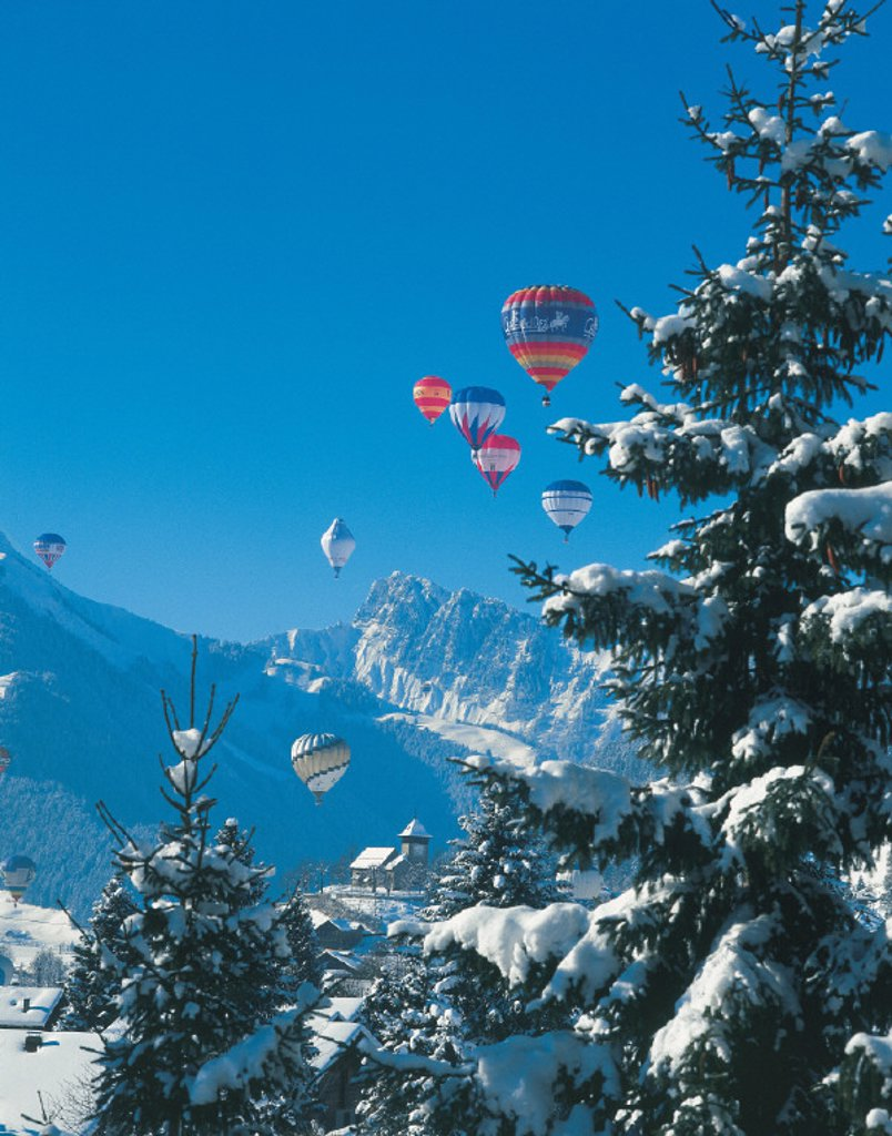 Stock Photo: 1597-12278 canton Vaud, Chateau d´Oex, hot air balloon, meeting, mountains, occasion, several balloons, sky, snow, spare time,
