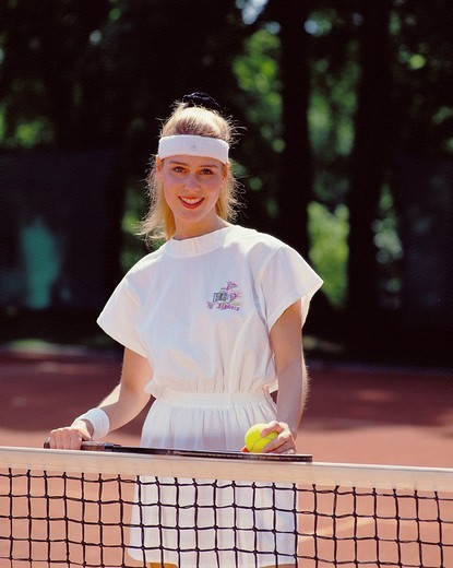 Stock Photo: 1597-131008  tennis, sport, woman, portrait, net, equipment, props, tennis court,