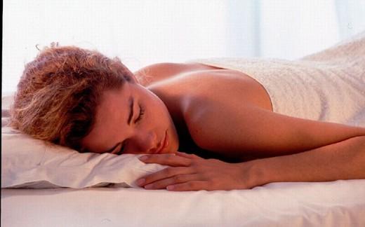 Stock Photo: 1597-13638 bed, dozing, recumbent, lie, lying, relax, sleeping, Wellness, were relaxing, Woman