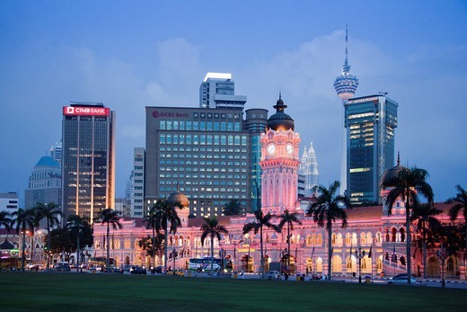 Malaysia, Asia, Kuala Lumpur, town, city, Merdeka place, Skyline, park, flowers, violet, blocks of flats, high_rise buildings, tower, rook, Abdul Samad, building, evening, at night, lights, illumination, pink : Stock Photo
