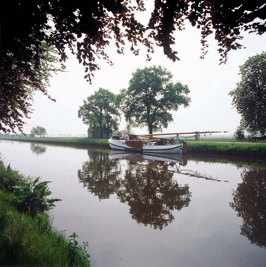 Netherlands, Holland, Europe, Drenthe, Nieuw_Amsterdam, canal, ship, landscape : Stock Photo