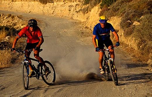 Stock Photo: 1597-14287 action, bicycle, bike, Biking, Downhill, dust, mountain bike, sports, two, men, way