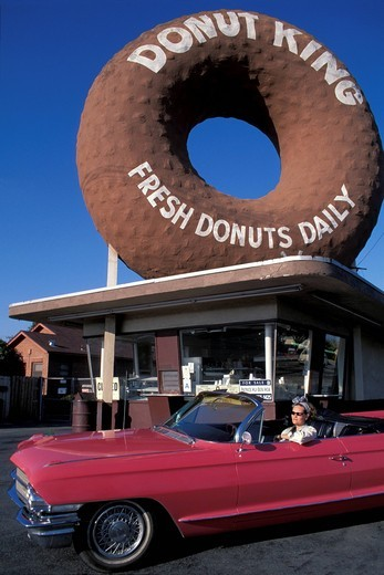 Stock Photo: 1597-156983 Donut King, Los Angeles, California, USA, United States, America, Giant donut, pink, Cadillac, 1962, woman, car, americana, LA