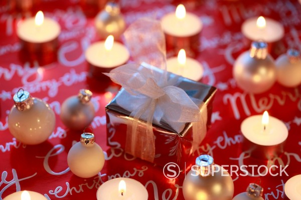 Stock Photo: 1597-158235 decoration, present, presents, glitter, candles, light, Merry Christmas, close_up, parcel, packet, Star, Stars, Mood, Studio, tealights, Christmas decoration, Christmas, Christmas decoration, mood, winter, decorative, elegant, gold, graphical, concepts, r. decoration, present, presents, glitter, candles, light, Merry Christmas, close_up, parcel, packet, Star, Stars, Mood, Studio, tealights, Christmas decoration, Christmas, Christmas decoration, mood, winter, decorative, elegant, gold, graphical,