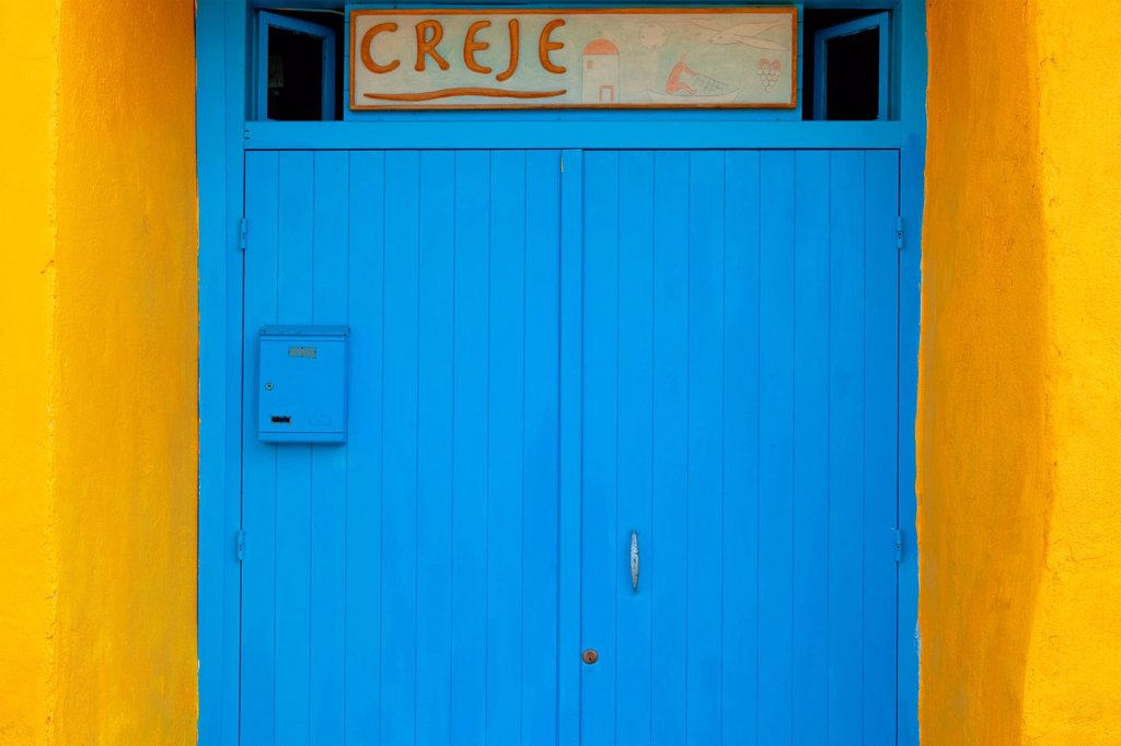 Italy, procida, Corricella _ architectual detail of yellow wall and blue door. : Stock Photo