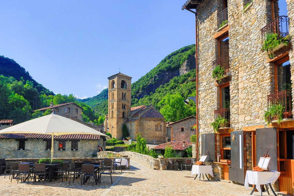 Stock Photo: 1597-164684 Spain, Europe, Catalonia, Girona Province, Beget, San Cristofol, architecture, belfry, church, girona, medieval, mountain, natural, nature, picturesque, Pyrenees, restaurant, Romanic, skyline, terrace, tourism, travel, umbrella,