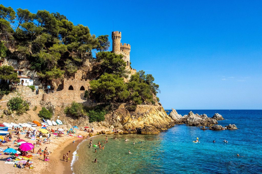 Stock Photo: 1597-164748 Spain, Europe, Catalonia, Costa Brava Coast, Lloret de Mar, town, Beach, beach, blue, castle, cliff, coast, colourful, Costa, Costa Brava, holiday, leisure, Mediterranean, summer, tour, tourism, umbrellas, vacation, water, sea,