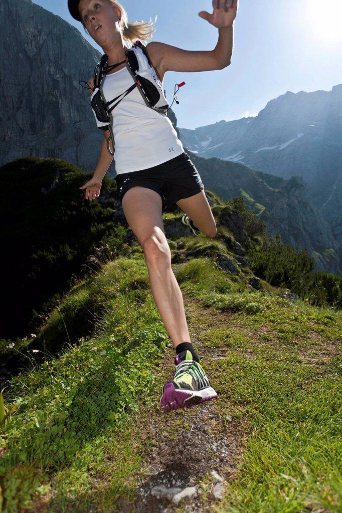Stock Photo: 1597-165449 Trailrunning, Trail running, Trail, Ramsau, Dachstein, Styria, Austria, woman, meadow, running, walking, run, mountains, mountain run, jogging, sport, fitness, health,
