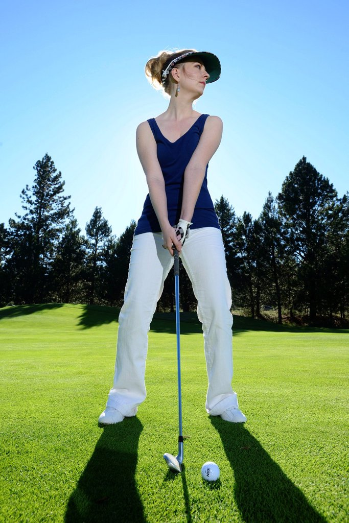 Stock Photo: 1597-171498 Oregon, USA, United States, America, Pacific Northwest, woman, golf, golfer, white pants, green, lawn, sport, resort,