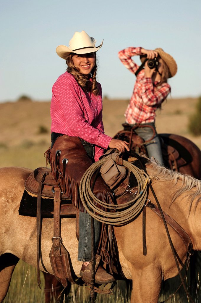 Stock Photo: 1597-172054 American West, Pacific Northwest, Oregon, USA, United States, America, cowgirl, girl, woman, riding, horseback, sport, horse, ranch, hat, photography