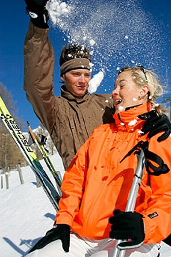 Stock Photo: 1597-20053 amusing, coats, Couple, cross_country skiing, cross country skiing winter sports, fun, gloves, jackets, joke, joy, m