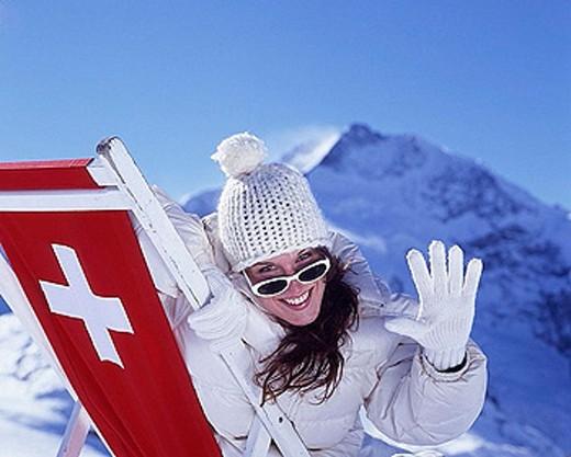 woman, cap hat, winter jacket, fun, joke, joy, winter, deck chair, take it easy, relax, Swiss cross, sunbath, mountain : Stock Photo