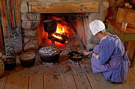 Stock Photo: 1597-28146 museum, woman, fire, cooking, boiling, preparation, food, eating, chimney, fireplace, folklore, colonist settler, Colo