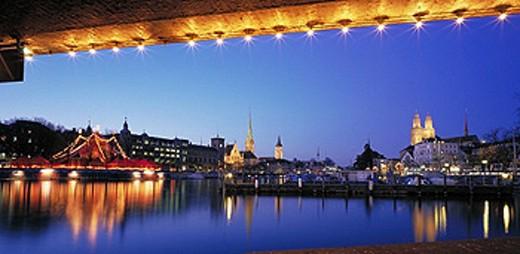 illuminated, , Bauschänzli, view, from Quaibrücke, dusk, twilight, churches, Limmat, river, flow, Switzerland, Europe, : Stock Photo