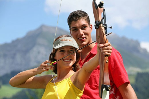 Outdoor, Outdoors, Outside, archery, bow, crossbow, shoot, arrow, target, weapon, woman, man, two, persons, instructor : Stock Photo