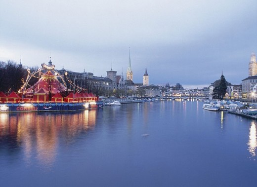 Stock Photo: 1597-4859  dusk, twilight, churches, Limmat, river, flow, Switzerland, Europe, Christmas, circus Conelli, town, city, Zurich, d