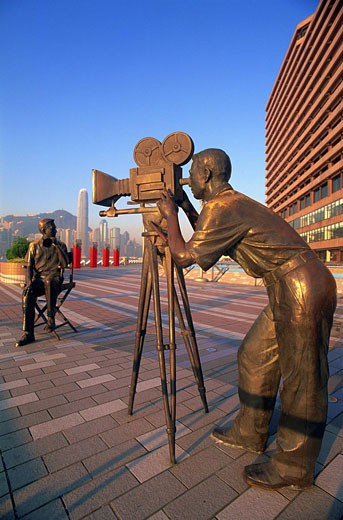 Asia, China, Hong Kong, Kowloon, Tsim Sha Tsui, Tsimshatsui, Avenue of Stars, Film Awards, Film Industry, Film Maker, Director, Producer, Sculpture, Statue, Statues, Promenade, Waterfront, Victoria Harbour, Harbour, Skyline, City, Cityscape, Skyscrapers, : Stock Photo