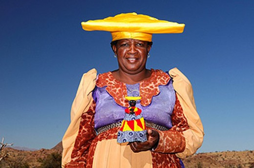 Stock Photo: 1597-58770 Herero people, woman, Damaraland, Kunene Region, Namibia, Africa, local woman, locals, native, natives, outdoors, outdoor, doll, colorful, colourful, costume, hat, tradition, traditional, portrait