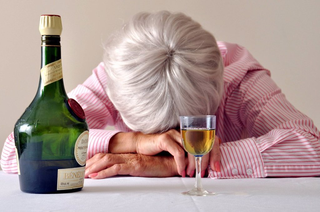 Stock Photo: 1597-59631 Liqueur, Single, Desperate, Headache, Drunk, Sad, Alcohol, Senior, Woman, Drinking, Pensioner, Old, Deprissed, Alone, Sick, Unhappy, Lonely, At Home, Sleep, Sleeping, Bottle, Glass