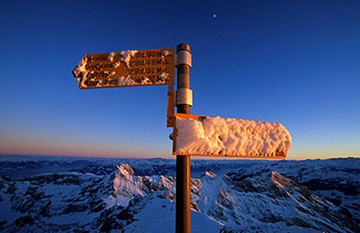 Stock Photo: 1597-60020 View, Säntis, Switzerland, Canton of Appenzell, Innerrhoden, Alp stone, vantage point, panorama, signpost, footpath, evening light, snow, winter, Landscape, scenery, nature, alps, alpine, mountain, mountains, signs, hiking, trail, trails