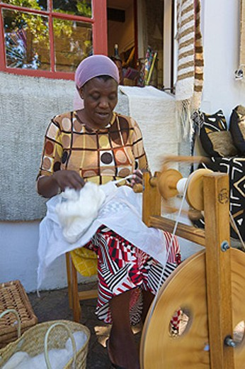 African woman spinning silk, Stellenbosch, South Africa : Stock Photo