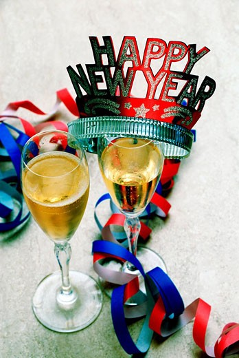 Stock Photo: 1597-63926 Happy New Year, New Year Eve, Celebrate, Celebrating, Celebration, Party, Paper streamer, sparkling wine, glasses, cha