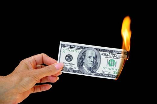 Money, note, bill, 100, one hundred Dollar, flame, fire, burn, cash, destroy, broken, depreciation, inflation, financi : Stock Photo