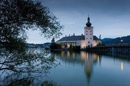 Lake castle, Ort, Austria, Upper Austria, castle, island, isle, lake, wooden footbridge, footbridge, lanterns, lighting, investigation, dusk, twilight, reflection, tree : Stock Photo