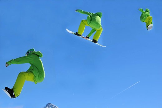 Switzerland, Valais, Verbier, snowboard, snowboarding, jump, jumping, acrobat, acrobatics, sensational, spectacularly, high, jump, sport, Courageously, courage, helmet, competition, ski acrobatics, air, aviation, scissors, pincers, no model release, pictu : Stock Photo
