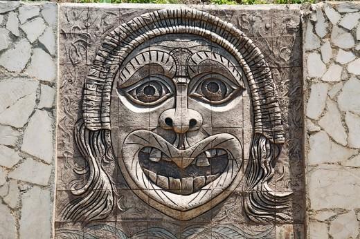 Darstellung einer Fratze an einer Wand, apotropaeische Maske in Palmi, Kalabrien, Italien : Stock Photo