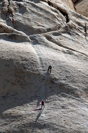 Stock Photo: 1597-81351 Rock climbers on monzonite granite, Joshua Tree National Park
