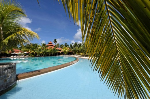 Sainte Anne,the Seychelles,Seychelles,hotel Sainte Anne Beachcomber Resort,pool,palms : Stock Photo