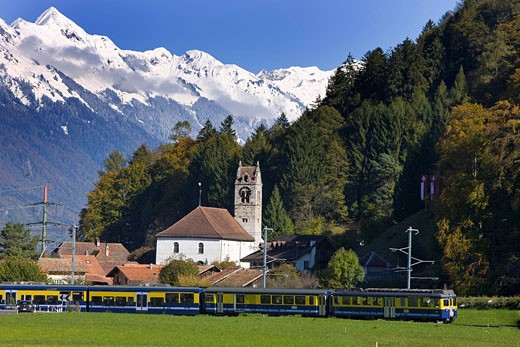 Stock Photo: 1597-82716  Switzerland, swiss, scenery, BOB, Wilderswil, Bernese Alps, mountains, canton Bern, wood, forest, trees, road, railway, train, railroad, scenery, snow, church
