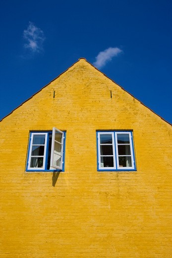 Aeroskobing, Denmark, island, isle, Aero, town, city, house, home, window, yellow house color, clouds : Stock Photo