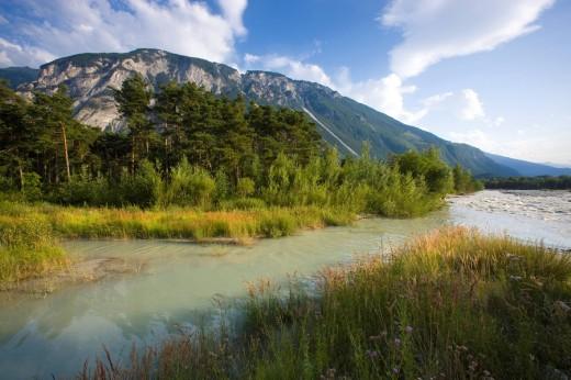 Pfynwald_Rhône, Switzerland, canton Valais, river, flow, Rhône, current, stream, Auwald, riverside, mountain, clouds : Stock Photo