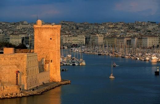 Marseille, France, Provence, Bouches_du_Rhône, town, city, sea, harbour, port, ships, port entrance, tower, rook, houses, homes, : Stock Photo