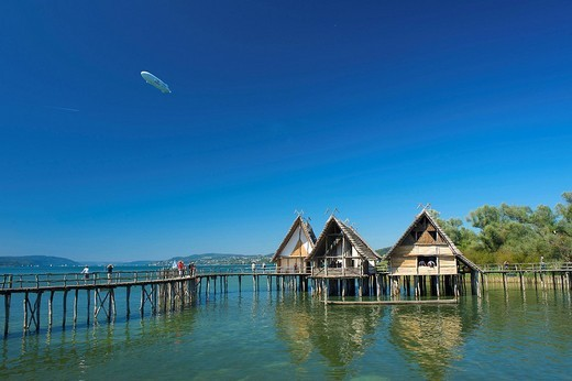 Stock Photo: 1597-86696 Baden_Wurttemberg, Lake of Constance, Germany, person, persons, people, building on stilts, Unteruhldingen, building on stilts museum, place of interest, places of interest, famous, tourist attraction, tourism, destination, beach bath, lake dwelling, pile