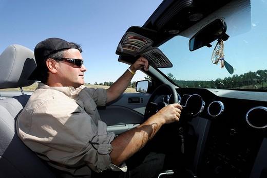 Stock Photo: 1597-87987 Charly Juchler driving his Mustang, Black Hills, near Hermosa, South Dakota, USA