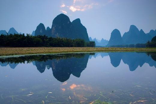 Stock Photo: 1597-93185 Li River, China, Asia, river, flow, dusk, mountains, karst, karst landscape, bamboo wood, reflection