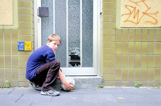 Boy, disc, slice, broken, windowpane, football, soccer, assurance, insurance, damage, harm, front door, Germany, Europe : Stock Photo