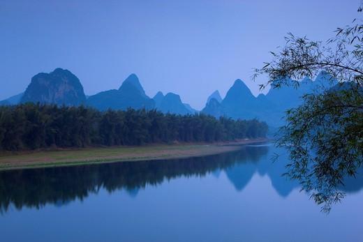 Li River, China, Asia, river, flow, daybreak, mountains, karst, karst landscape, bamboo, reflection : Stock Photo