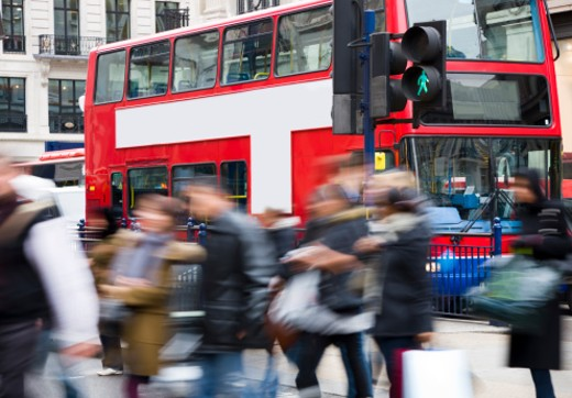 shopping in London,people crossing the street in London (Oxford Street/Oxford Circus), motion blur : Stock Photo